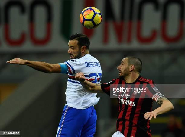 Leonardo Bonucci of AC Milan and Fabio Quagliarella of UC Sampdoria compete for the ball during the serie A match between AC Milan and UC Sampdoria...
