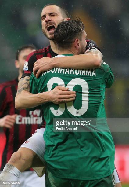 Leonardo Bonucci of AC Milan celebrates the victory with his teammate Antonio Donnarumma at the end of the TIM Cup match between AC Milan and FC...