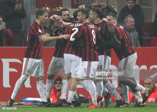 Leonardo Bonucci of AC Milan celebrates with his teammates after scoring the opening goal during the serie A match between AC Milan and FC Crotone at...