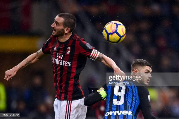 Leonardo Bonucci of AC Milan competes for a header with Mauro Icardi of FC Internazionale during the TIM Cup football match between AC Milan and FC...