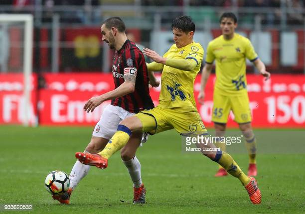 Leonardo Bonucci of AC Milan competes for the ball with Mariusz Stepinski of AC Chievo Verona during the serie A match between AC Milan and AC Chievo...