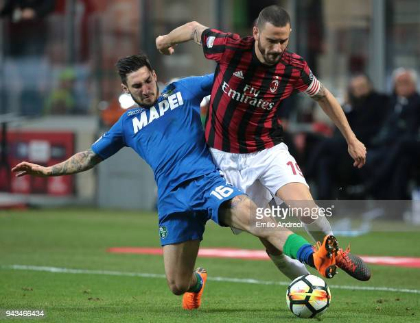 Leonardo Bonucci of AC Milan competes for the ball with Matteo Politano of US Sassuolo Calcio during the serie A match between AC Milan and US...