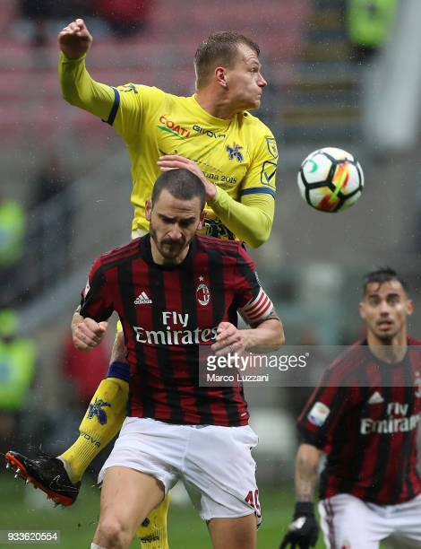 Leonardo Bonucci of AC Milan competes for the ball with Pawel Jaroszynski of AC Chievo Verona during the serie A match between AC Milan and AC Chievo...