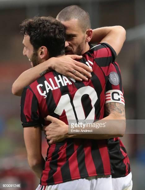 Leonardo Bonucci of AC Milan embraces his teammate Hakan Calhanoglu during the serie A match between AC Milan and UC Sampdoria at Stadio Giuseppe...