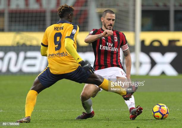 Leonardo Bonucci of AC Milan is challenged by Moise Kean of Hellas Verona FC during the Tim Cup match between AC Milan and Hellas Verona FC at Stadio...
