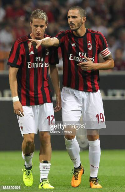 Leonardo Bonucci of AC Milan speaks to Andrea Conti during the UEFA Europa League Qualifying PlayOffs round first leg match between AC Milan and KF...