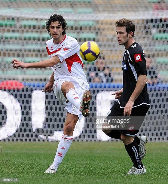 Leonardo Bonucci of AS Bari and Antonio Floro Flores of Udinese Calcio in action during the Serie A match between AS Bari and Udinese Calcio at...