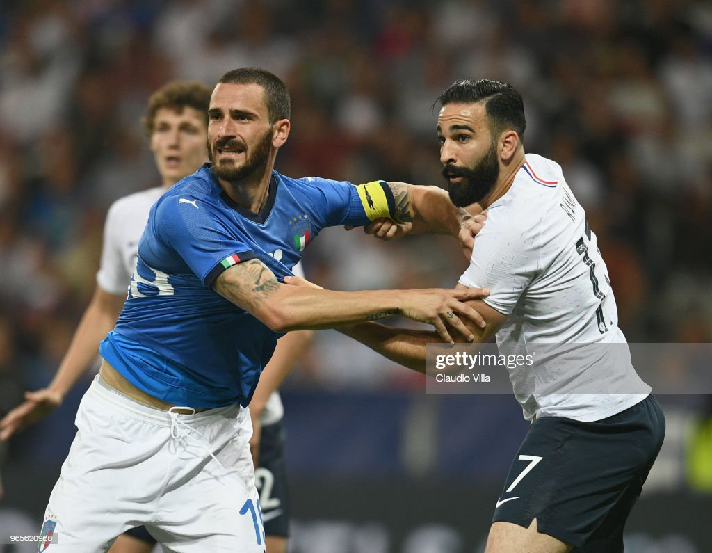 Leonardo Bonucci of Italy (L) and Adil Rami of France compete during the International Friendly match between France and Italy at Allianz Riviera Stadium on June 1, 2018 in Nice, France.