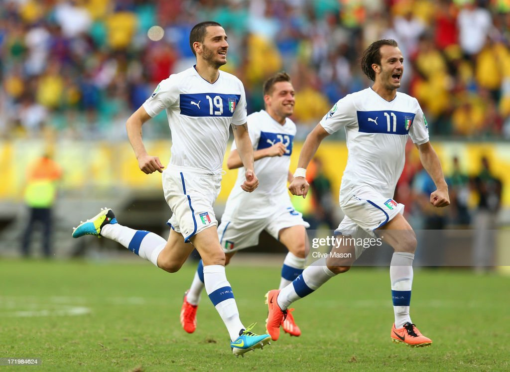 Leonardo Bonucci of Italy (L) and Alberto Gilardino celebrate after Gianluigi Buffon of Italy saved the penalty of Walter Gargano of Uruguay to clinch victory in a shootout during the FIFA Confederations Cup Brazil 2013 3rd Place match between Uruguay and Italy at Estadio Octavio Mangabeira (Arena Fonte Nova Salvador) on June 30, 2013 in Salvador, Brazil.