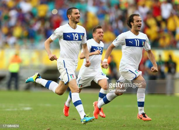 Leonardo Bonucci of Italy and Alberto Gilardino celebrate after Gianluigi Buffon of Italy saved the penalty of Walter Gargano of Uruguay to clinch...