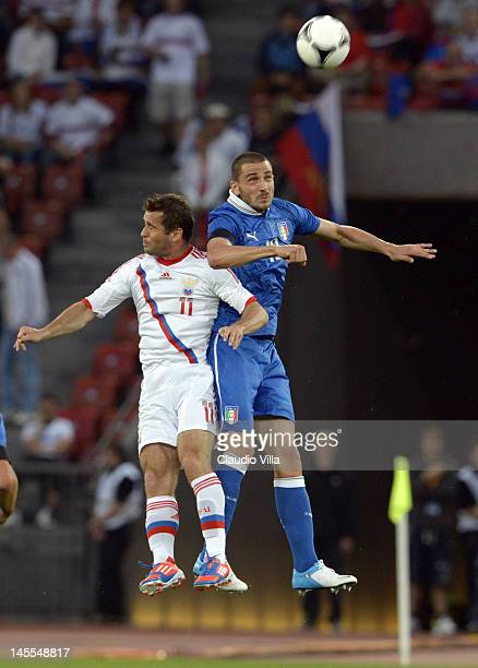 Leonardo Bonucci of Italy and Aleksandr Kerzhakov of Russia compete for the ball during the international friendly match between Italy and Russia at...