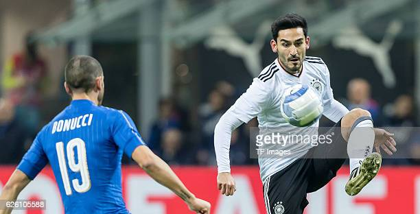 Leonardo Bonucci of Italy and Ilkay Guendogan of Germany battle for the ball during the International Friendly match between Italy and Germany at...