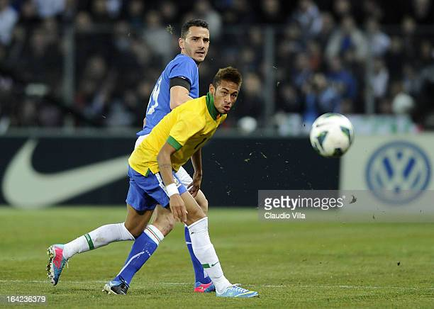 Leonardo Bonucci of Italy and Neymar of Brazil compete for the ball during the international friendly match between Italy and Brazil on March 21 2013...