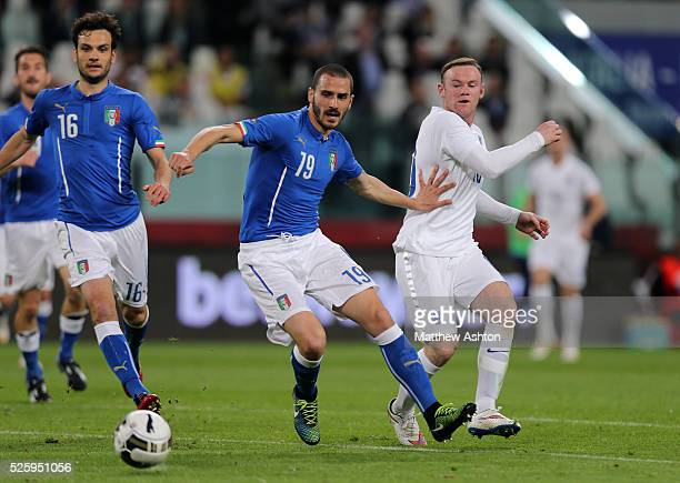Leonardo Bonucci of Italy and Wayne Rooney of England