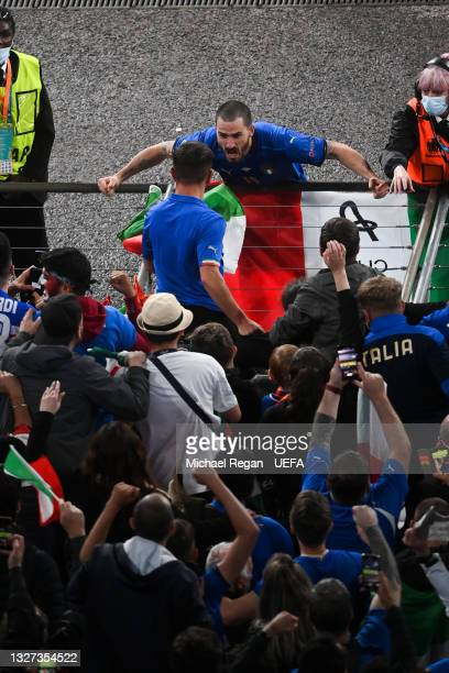 Leonardo Bonucci of Italy celebrates with the fans after victory in the UEFA Euro 2020 Championship Semi-final match between Italy and Spain at...