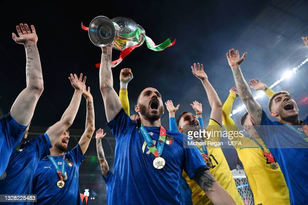Leonardo Bonucci of Italy celebrates with The Henri Delaunay Trophy following his team's victory in the UEFA Euro 2020 Championship Final between...