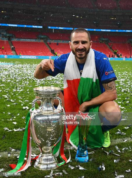 """Leonardo Bonucci of Italy celebrates with The Henri Delaunay Trophy and his Heineken """"Star of the Match"""" award following his team's victory in the..."""