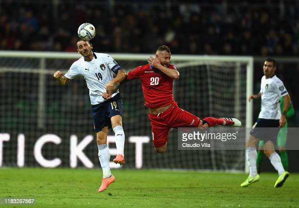 Leonardo Bonucci of Italy competes for the ball with Aleksandre Karapetyan of Armenia during the UEFA Euro 2020 Qualifier between Italy and Armenia...