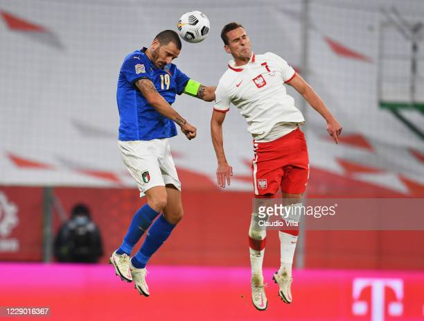 Leonardo Bonucci of Italy competes for the ball with Arkadiusz Milik of Poland during the UEFA Nations League group stage match between Poland and...