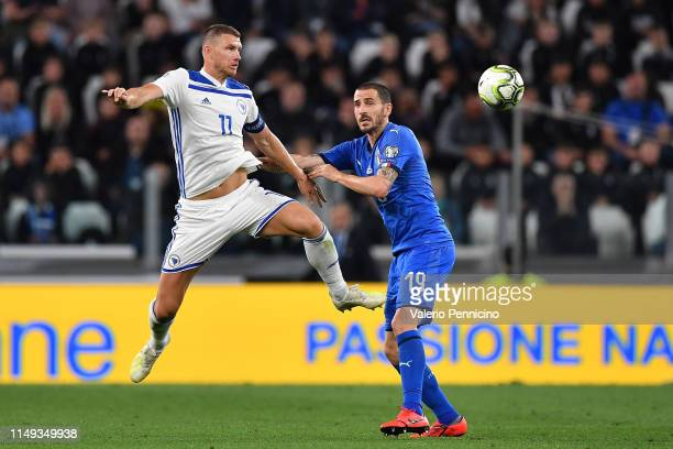 Leonardo Bonucci of Italy competes for the ball with Edin Dzeko of Bosnia during the UEFA Euro 2020 Qualifier between Italy and Bosnia and...