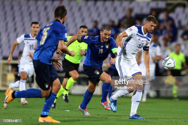 Leonardo Bonucci of Italy competes for the ball with Edin Dzeko of Bosnia and Herzegovina during the UEFA Nations League group stage match between...