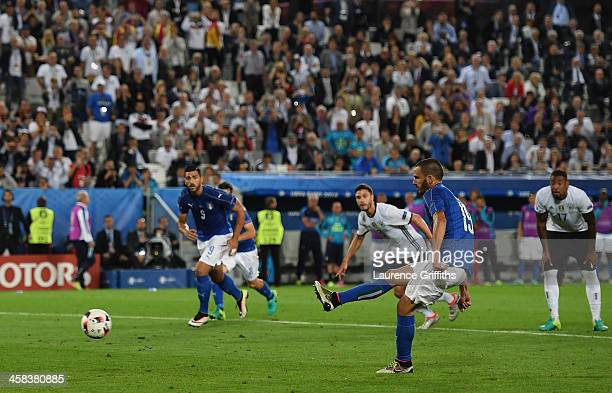 Leonardo Bonucci of Italy converts the penalty to score his team's first goal during the UEFA EURO 2016 quarter final match between Germany and Italy...