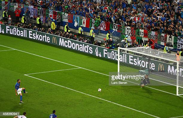 Leonardo Bonucci of Italy converts the penalty to score his team's first goal past Manuel Neuer of Germany during the UEFA EURO 2016 quarter final...