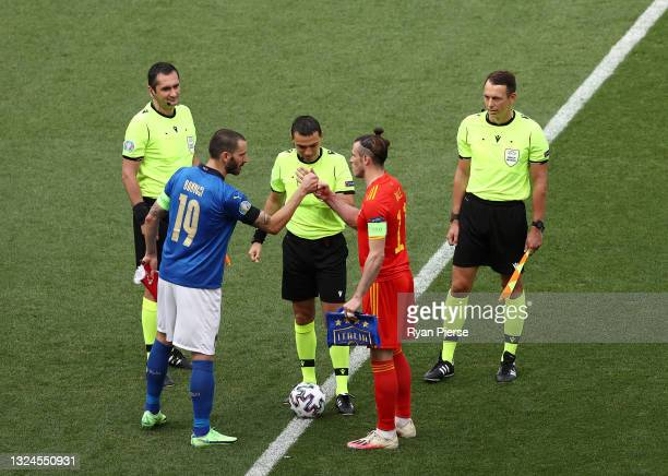 Leonardo Bonucci of Italy interacts with Gareth Bale of Wales as they conduct the coin toss prior to the UEFA Euro 2020 Championship Group A match...