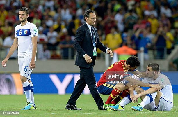 Leonardo Bonucci of Italy is consoled by Alvaro Arbeloa of Spain after missing a penalty in a shootout during the FIFA Confederations Cup Brazil 2013...