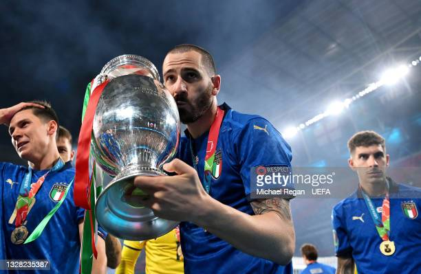 Leonardo Bonucci of Italy kisses The Henri Delaunay Trophy following his team's victory in the UEFA Euro 2020 Championship Final between Italy and...