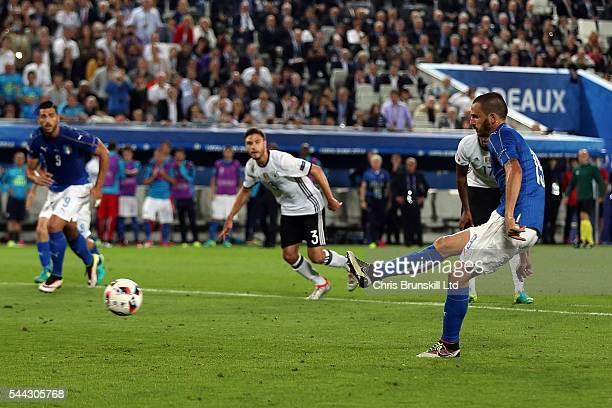 Leonardo Bonucci of Italy scores the equaliser from the penalty spot during the UEFA Euro 2016 Quarter Final match between Germany and Italy at...