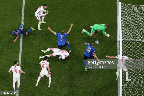 Leonardo Bonucci of Italy scores their side's first goal past Jordan Pickford of England during the UEFA Euro 2020 Championship Final between Italy...