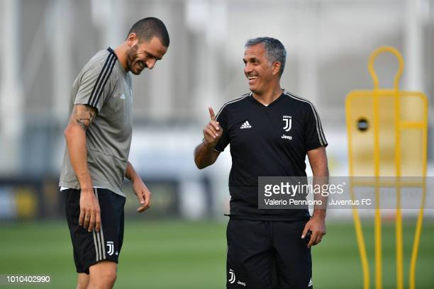 Leonardo Bonucci of Juventus and Aldo Dolcetti talk during a training session at JTC on August 3 2018 in Turin Italy