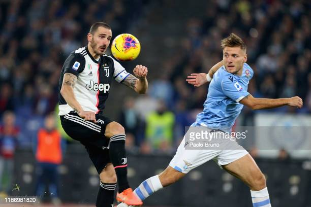 Leonardo Bonucci of Juventus and Ciro Immobile of SS Lazio compete for the ball during the Serie A match between SS Lazio and Juventus at Stadio...