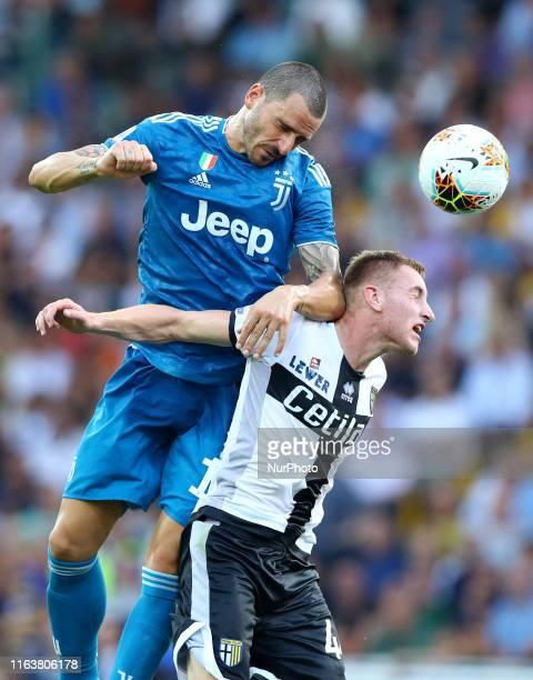 Leonardo Bonucci of Juventus and Dejan Kulusevski of Parma during the Serie A match Parma v Juventus at the Tardini Stadium in Parma Italy on August...