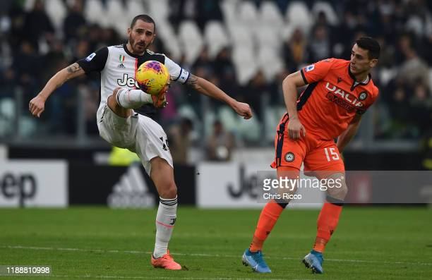 Leonardo Bonucci of Juventus and Kevin Lasagna of Udinese during the Serie A match between Juventus and Udinese Calcio at Allianz Stadium on December...
