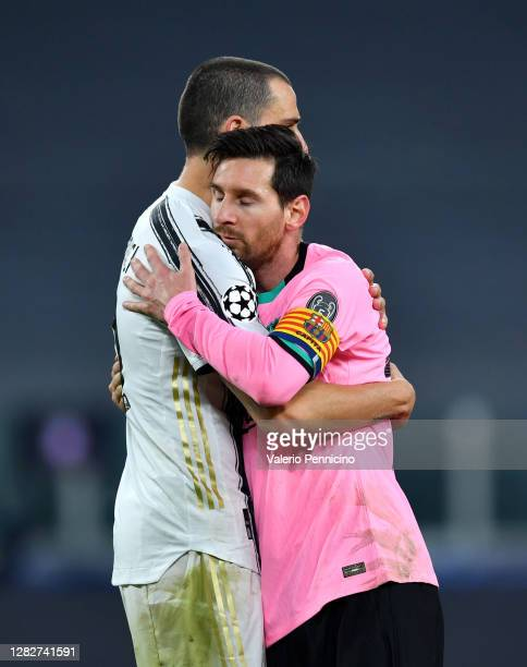 Leonardo Bonucci of Juventus and Lionel Messi of Barcelona embrace following the UEFA Champions League Group G stage match between Juventus and FC...