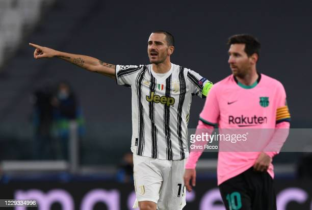Leonardo Bonucci of Juventus and Lionel Messi of FC Barcelona react during the UEFA Champions League Group G stage match between Juventus and FC...