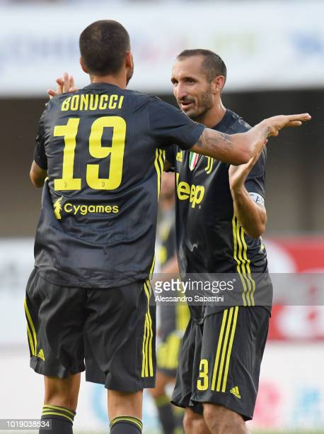 Leonardo Bonucci of Juventus celebrates after scoring his team third goal with Giorgio Chiellini during the serie A match between Chievo Verona and...