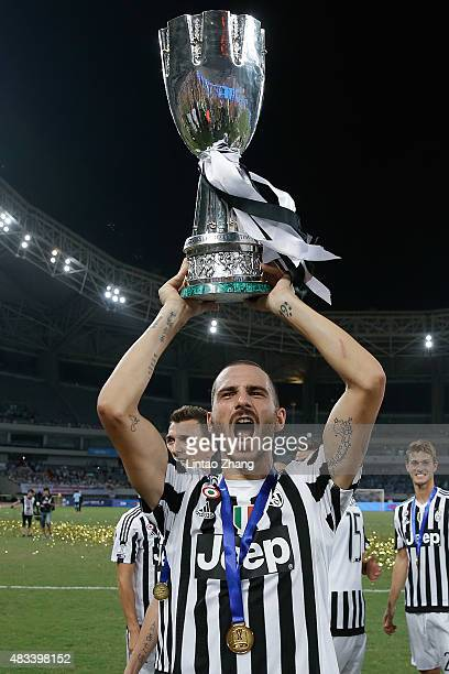 Leonardo Bonucci of Juventus celebrates with the trophy after winning the Italian Super Cup final football match between Juventus and Lazio at...