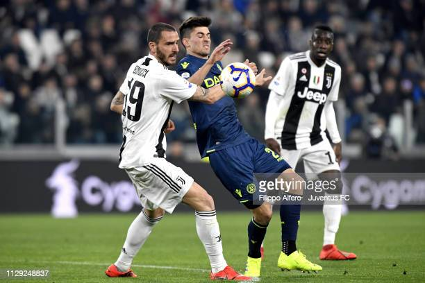 Leonardo Bonucci of Juventus competes for the ball with Ignacio Pussetto of Udinese during the Serie A match between Juventus and Udinese at Allianz...