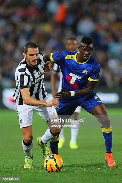 Leonardo Bonucci of Juventus competes with Bernie Ibini of the All Stars during the match between the ALeague All Stars and Juventus at ANZ Stadium...