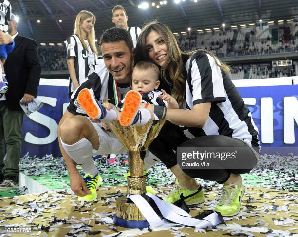 Leonardo Bonucci of Juventus FC and his family celebrate with the Serie A trophy after the Serie A match between Juventus and Cagliari Calcio at...