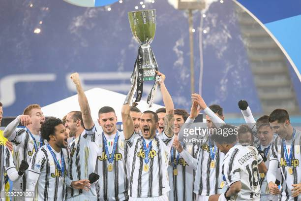 Leonardo Bonucci of Juventus FC and his teammates celebrate after winning the Italian Super Cup Final match between FC Juventus and SSC Napoli at the...
