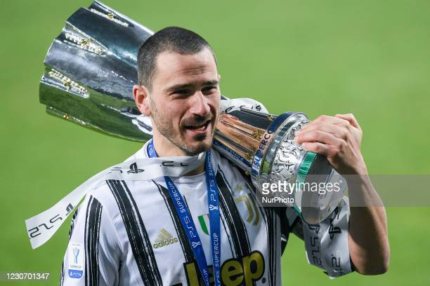 Leonardo Bonucci of Juventus FC celebrates with the trophy after winning the Italian Super Cup Final match between FC Juventus and SSC Napoli at the...