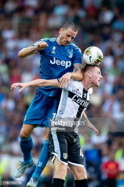 Leonardo Bonucci of Juventus FC challenges Dejan Kulusevski of Parma Calcio during the Serie A match between Parma Calcio 1913 and Juventus at Stadio...