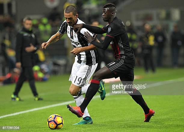 Leonardo Bonucci of Juventus FC cis challenged by M'Baye Niang of AC Milan during the Serie A match between AC Milan and Juventus FC at Stadio...