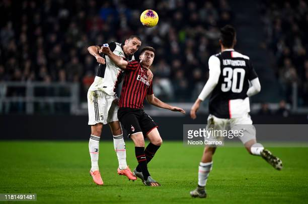 Leonardo Bonucci of Juventus FC competes for a header with Krzysztof Piatek of AC Milan during the Serie A football match between Juventus FC and AC...