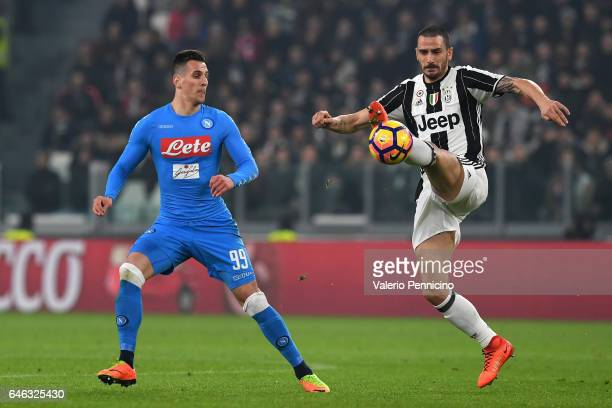 Leonardo Bonucci of Juventus FC controls the ball against Arkadiusz Milik of SSC Napoli during the TIM Cup match between Juventus FC and SSC Napoli...