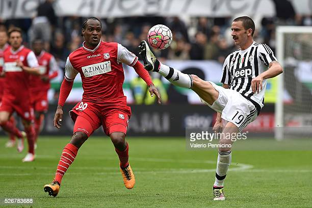 Leonardo Bonucci of Juventus FC controls the ball against Jerry Uche Mbakogu of Carpi FC during the Serie A match between Juventus FC and Carpi FC at...